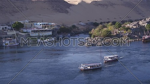 Aerial Shot for the River Nile showing motorboats in Aswan at Day.