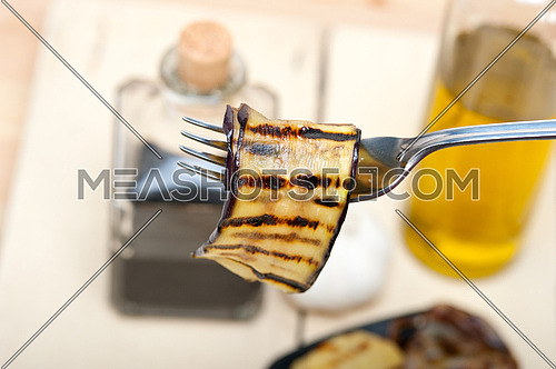 grilled eggplant oubergine on a fork macro close up