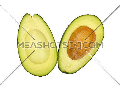 One fresh green ripe avocado (Persea gratissima) cut in two halves with pit stone isolated on white, detail, close up, elevated top view, high angle
