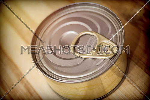 Tin on a wooden board in a kitchen