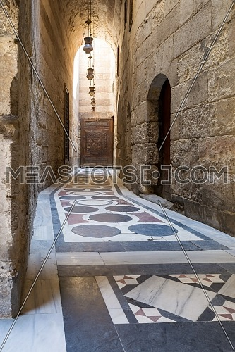 Vaulted passage leading to the Courtyard of Sultan Qalawun mosque with geometrical pattern colorful marble floor, Moez Street, Old Cairo, Egypt