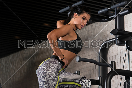 Portrait Of A Sexy Sporty Latina Woman In The Gym With Exercise Equipment