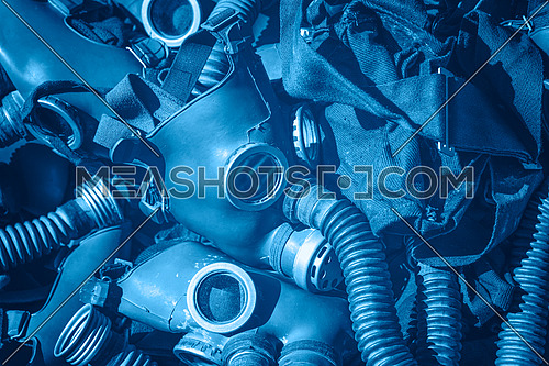 Close up blue toned background of old vintage classic protective gas respirator masks on retail display