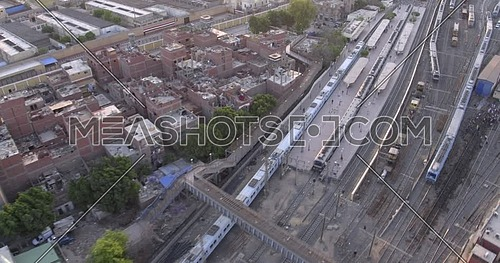 Aerial shot for Railway while Metro is getting inside the station showing the Urban in Cairo at day