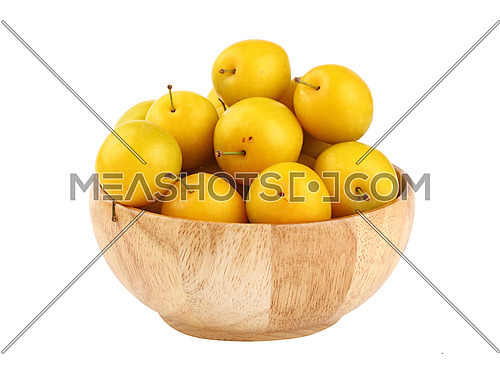 Mellow ripe fresh yellow cherry plums in wooden bowl isolated on white background, close up, side view