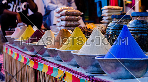 Close up on colorful powder herbs in display in a shop