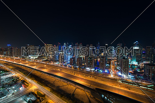 dubai marina at night showing sheikh zayed road