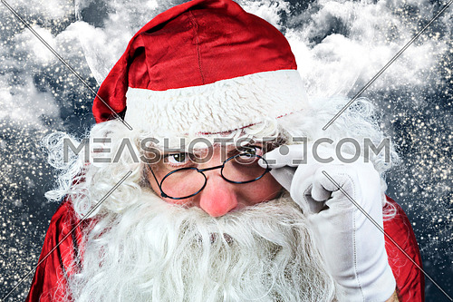 Portrait Of Santa Claus in the Christmas Night , with Sky full of Stars, Snow, Clouds and The Moon in the Background