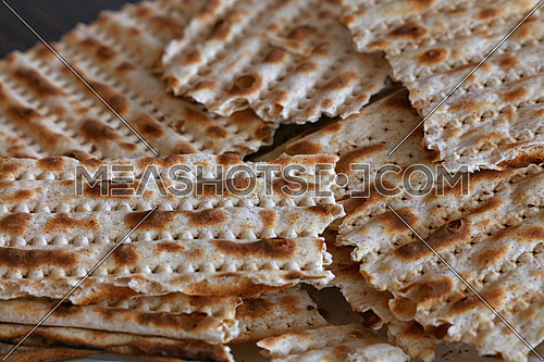 Close up square pieces of matzo flatbread crackers, traditional Jewish crispbread