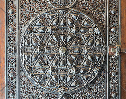 Ornaments of the bronze-plate ornate door of the mosque of The Manial Palace of Prince Mohammed Ali Tewfik, Cairo, Egypt