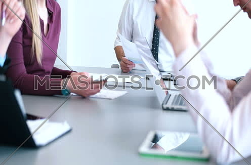 mid-shot  for Casual Business Team Hands In A Meeting In A Light Modern Office sho