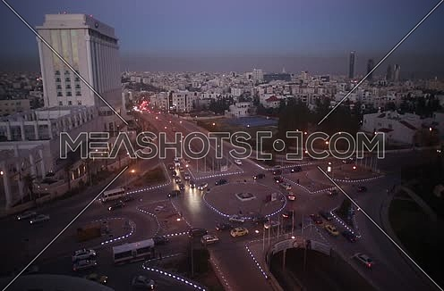 General Shot For Fifth Circle Showing Four Seasons Hotel On The Left And Medium Car Traffic And Showing Abdali Towers In The Background (Sun Set )