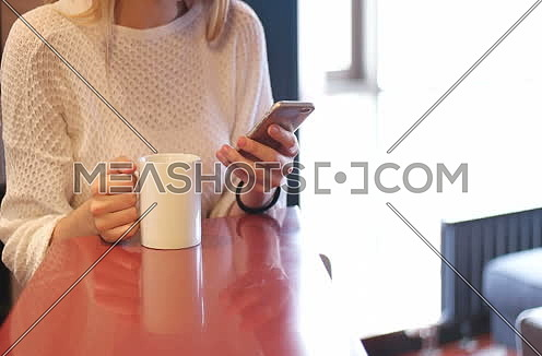 Blonde drinking coffee enjoying relaxing lifestyle