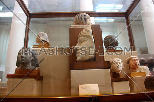 a photo from inside the Egyptian museum showing a display of monumental statues belonging to the pharaohs civilization