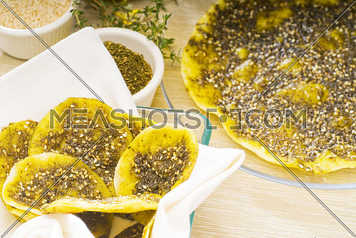 lebanese manouche or manoushe ,lebanese pizza with thyme and sesame seeds,zaatar, and extra virgin olive oil on top