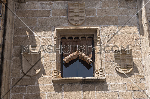 Typical window of the old town of Caceres, Spain