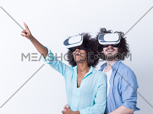 Happy multiethnic couple getting experience using VR headset glasses of virtual reality, isolated on white background