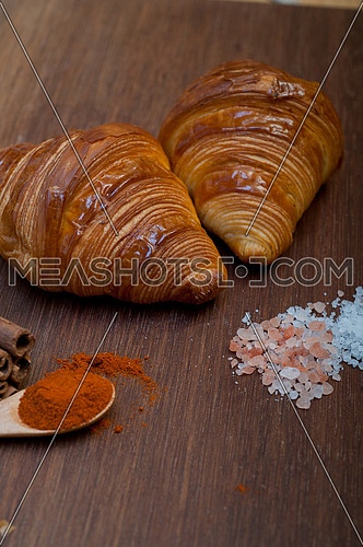 french traditiona croissant brioche butter bread  on wood