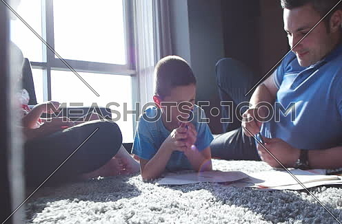 kids with parents coloring and developing new skills in living room