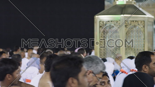 Close up (Slow-Motion) for Mulsim pilgrims during Tawaf around Kaaba.