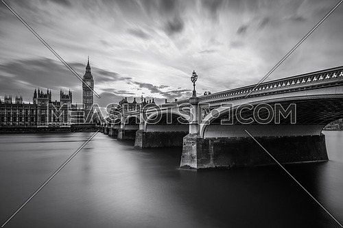 a black and white image of Westminster Bridge and BigBen, London