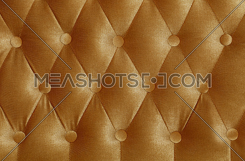 Beige brown capitone textile background with buttons, retro Chesterfield style soft tufted fabric furniture upholstery diamond pattern decoration, close up