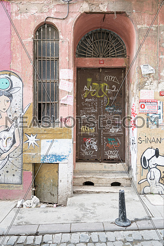 Istanbul, Turkey - April 18, 2017: Grunge metal door with random paints, Istanbul, Turkey