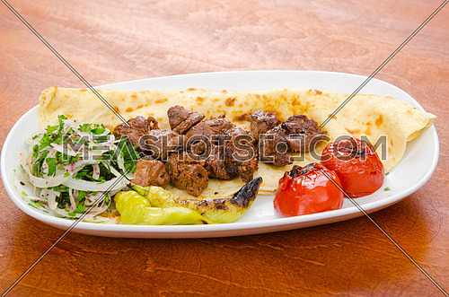 Kebab served in the plate
