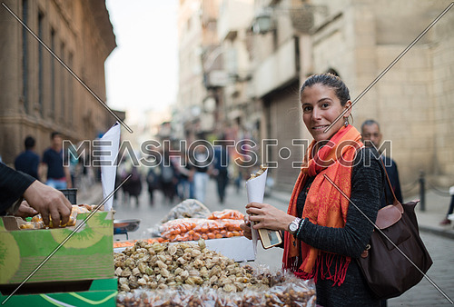 Young middle eastern woman in the traditional street market