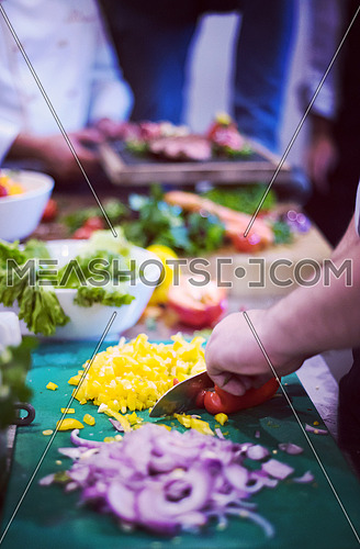Chef hands cutting fresh and delicious vegetables for cooking or salad