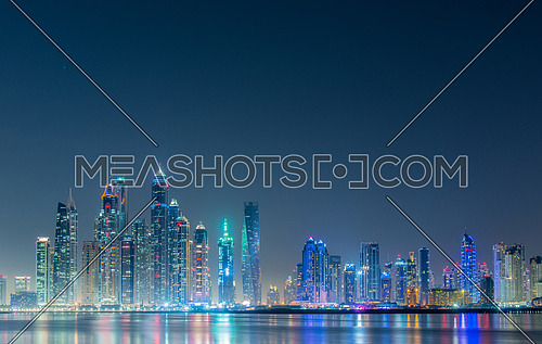 DUBAI - JANUARY 8, 2015: Dubai Marina skyscrapers on January 8 in UAE, DUBAI. Dubai Marina skyscrapers are among the higherst in the world