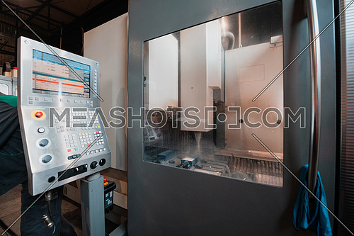 machine control panel CNC with the image of the details on the screen. High quality photo