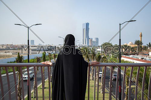 Saudi lady standing in a bridge