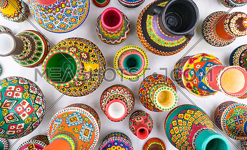 Composition of artistic painted handcrafted pottery jars