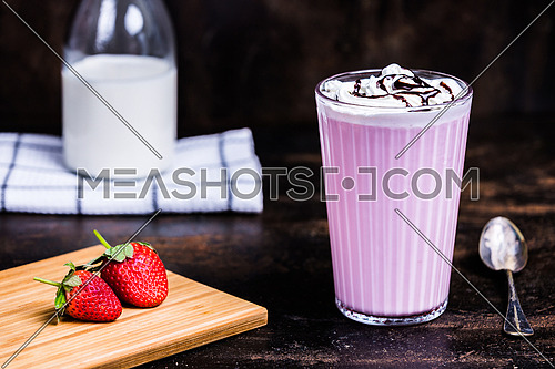 Strawberry Milk drink with whipped cream and chocolate syrup
