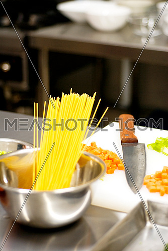 italian spaghetti pasta on a typical full equipped restaurant kitchen