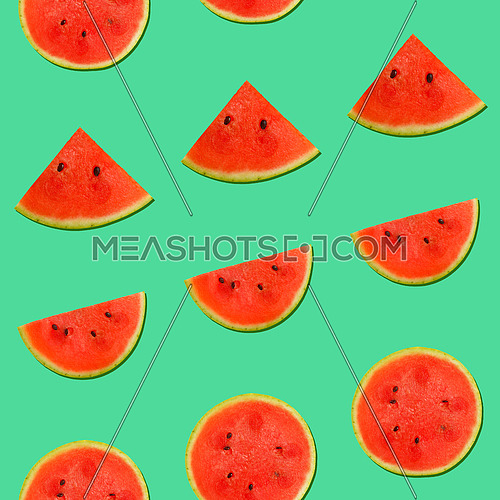 Seamless pattern of fresh red ripe juicy watermelon round cut wedges on vivid teal blue background