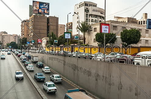Zoom OUT Shot for traffic from above Al Thawra Tunnel at Daytime