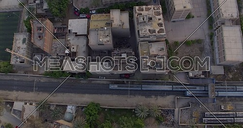 Aerial Top shot for two Metro's Passing by each other in Cairo at sunset