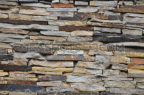 Old style rough stone rock wall texture