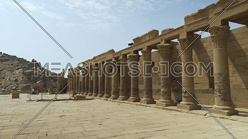 Revealing shot inside Temple of Phila showing columns, Aswan Egypt by day