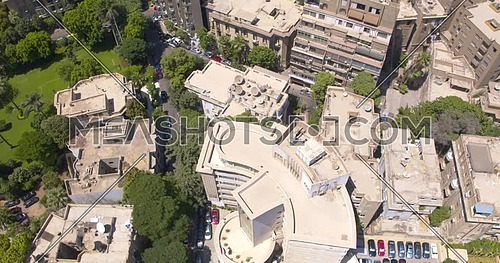 Lift off Shot drone for Buildings and gardens in Garden City area in Cairo at Day
