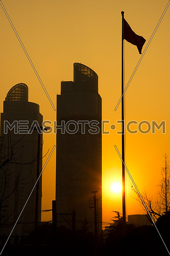 shanghai twins towers over an orange sky during sunset