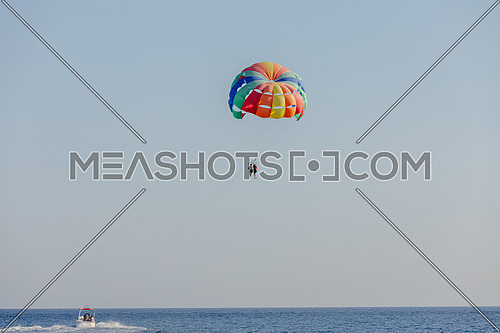 Long for for tourist parasailng in the Red Sea by day
