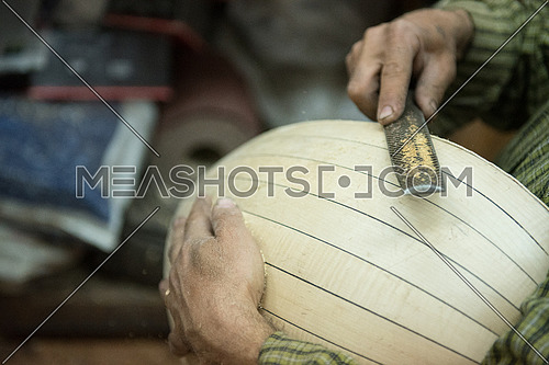 Softening the Back wooden box of an Egyptian Oud during its assembling