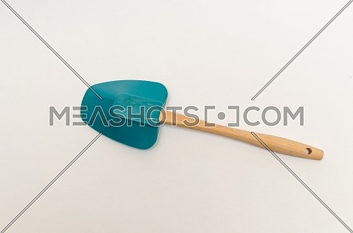 A wooden and silicone kitchenware / utensils. (a spoon / ladle / spatula)