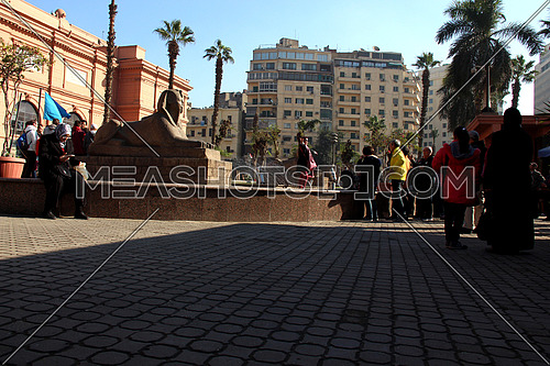 a photo from the yard of the Egyptian Museum showing the garden, statues & Tahrir square
