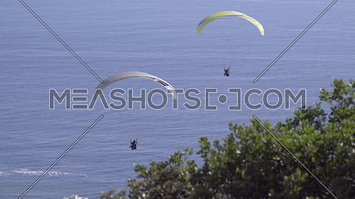View of two para-gliders drifting in the wind near Cape Town