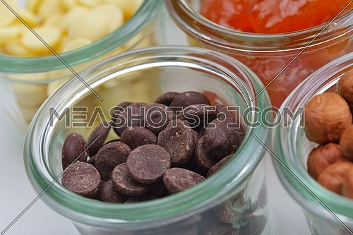 nuts and dry fruits mix healthy organic food mix in glass bowls isolated on white background