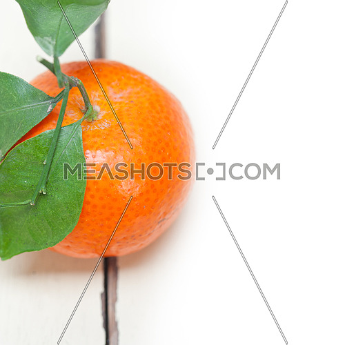 tangerine mandarin orange on white rustic wood table